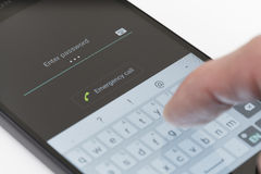 Entering password on Android phone Royalty Free Stock Photography