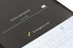 Entering password on Android phone. Melbourne, Australia - May 23, 2016: Entering password on the lock screen of an Android phone. The lock screen improves stock photography