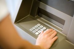 Entering PIN at ATM Stock Image