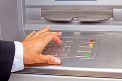 Entering pin code. In the cash machine Royalty Free Stock Image
