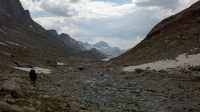 Entering Titcomb Basin from the north. Hiking through glacier melt into Titcomb Basin, Wind River Range, Wyoming royalty free stock photo