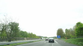Entering to Lyon, France. Speedy driving cars on the highway and entrance sign to Lyon city (Rhone-Alpes Department)  in France, Europe stock footage
