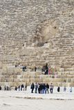 Entering the tomb. Sightseeing tourists around the Pyramids of Giza Egypt Royalty Free Stock Photography