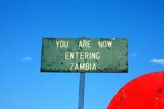 Entering zambia. Road sign between zambia and zimbabwe Stock Photo