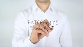 Enterprise Resource, Man Writing on Glass. High quality stock image