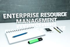 Enterprise Resource Management. Text concept with chalkboard, notebook, pens and mobile phone. 3D render illustration Royalty Free Stock Images