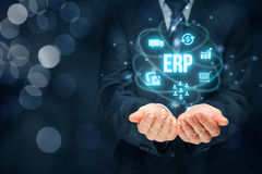 Enterprise resource planning ERP. Concept. Businessman offer ERP business management software for collect, store, manage and interpret business data about Royalty Free Stock Images