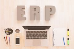 Enterprise Resource Planning. ERP - Enterprise Resource Planning - text concept with notebook computer, smartphone, notebook and pens on wooden desktop. 3D Stock Photography