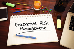 Enterprise Risk Management. Handwritten text in a notebook on a desk - 3d render illustration Royalty Free Stock Photos