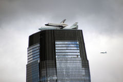 Enterprise Space Shuttle. Flying over Goldman Sachs Tower in Jersey City, New Jersey  on it's way to retirement at the Intrepid museum in Manhattan Royalty Free Stock Photo