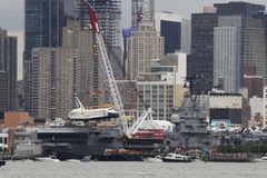 Enterprise Space Shuttle, NYC. Space Shuttle, Enterprise is lowered onto the Intrepid Sea, Air and Space Museum on Royalty Free Stock Images