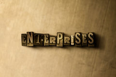 ENTERPRISES - close-up of grungy vintage typeset word on metal backdrop Stock Photography