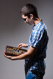 Enterprising young man with an abacus. Stock Images