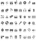 Entertainment Icons Collection Black on White. Illustration featuring collection of 48 grey black entertainment icons or symbols with reflection isolated on Royalty Free Stock Photography