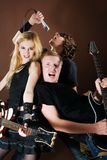 Entertaiment in studio. Funny rock band playing in photostudio Stock Images