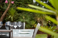 Entertain outdoors. A table setting in the garden ready for outdoor entertaining Royalty Free Stock Images
