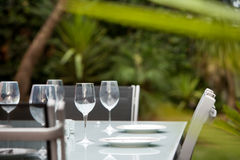 Entertain outdoors. A table setting in the garden ready for outdoor entertaining Stock Photography