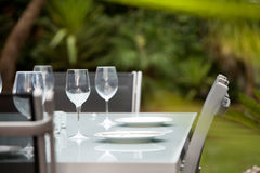 Entertain outdoors. A table setting in the garden ready for outdoor entertaining Royalty Free Stock Photo
