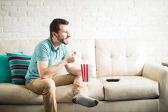 Entertained man watching movies Royalty Free Stock Images