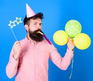 Entertainer with colorful baloons at kids party, international childrens day. Bearded artist with party wistle and paper. Star shaped glasses wearing birthday royalty free stock images