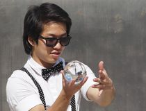 Entertainer With Crystal Ball. In downtown Edmonton July, 2016 Royalty Free Stock Image
