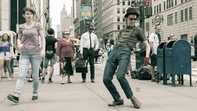 Entertainer dancing with a yo-yo on the street royalty free stock image
