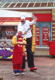 Entertainers in costume. Chorley, Lancashire, UK. 11th May 2014. Entertainers in costume and on stilts at the first ever food festival to be held in Chorley royalty free stock photo
