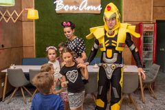 Entertainers playing with happy kids during children protection day inside cafe. In Ukraine royalty free stock images