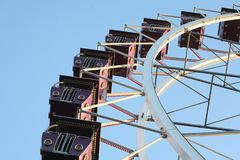 Entertaining attraction with a Ferris wheel stock images