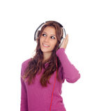 Entertaining girl with headphones listening to music Royalty Free Stock Images