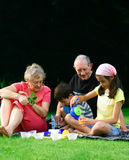 Entertaining grandchildren Stock Images