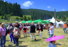 Entertaining people at mountain fair site Royalty Free Stock Image
