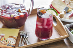 Entertaining with red sangria and party hors D'oeuvres Stock Image