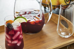 Entertaining with refreshing ice cold red sangria. Entertaining is fun with refreshing red sangria.  Made with red wine, the pitcher of sangria is also filled Royalty Free Stock Photography
