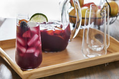 Entertaining with refreshing red sangria. Entertaining is fun with refreshing red sangria.  Made with red wine, the pitcher of sangria is also filled with Royalty Free Stock Images