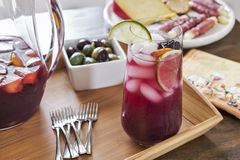 Entertaining with refreshing red sangria and party hors D'oeuvres. Entertaining is fun with refreshing red sangria and festive party hors D'oeuvres.  Made with Royalty Free Stock Image
