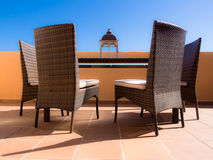 Entertaining in the sun. 4 chairs, one table, a view that is relaxing, warm and inviting Stock Photo