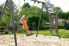 Entertainment . The girl shakes on a swing Royalty Free Stock Photos