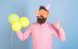 Entertainment artist at kids party, International children day celebration. Bearded man with huge glasses, wistle and. Balloons, fun concept. Hipster with royalty free stock images