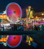 Entertainment and Attractions at the fair in Portugal. People having fun Stock Images