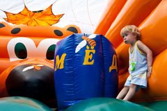 Entertainment for children on bouncy castle Royalty Free Stock Photography