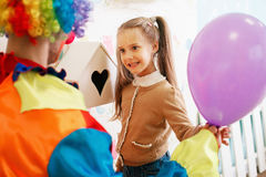 Entertainment with clown in colourful costume. Stock Photography