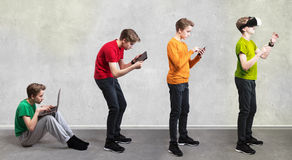 Entertainment evolution concept. Teen with IT gadgets Royalty Free Stock Images