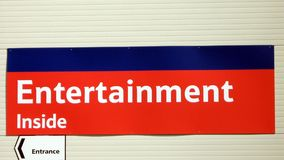 Entertainment inside sign. entrance sign. Sign directing to an entertainment arcade games center Stock Photography