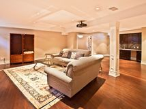 Entertainment Room. Modern home entertainment room in the basement Royalty Free Stock Image