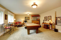 Entertainment room in hawaian style with pool table Royalty Free Stock Image