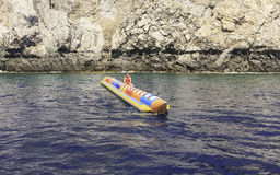 Entertainment at sea: banana. Rhodes Island. Greece Stock Photo
