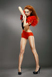Entertainment. Shapely Redhead Asian Showgirl in Night Disco Club. Dance Royalty Free Stock Image