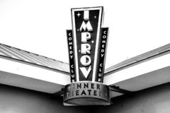 The entertainment side of Comedy. Orlando, FL/USA - July 1, 2018: A closeup view of the sign just above the ticket office at The Improv, a comedy club and dinner royalty free stock images