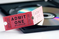 Entertainment stuff. Ticket and DVD, home-theater or entertainment concept Royalty Free Stock Image